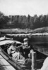 Original title:  Dr. and Mrs. Alexander Graham Bell in their motorboat Ranzo at Beinn Bhreagh.