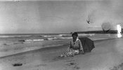 Original title:  Lucy Maud Montgomery on Cavendish shore, ca.1923. Cavendish, P.E.I. Courtesy of L. M. Montgomery Collection, Archival & Special Collections, University of Guelph.