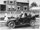 Original title:  Sir Henry Pellatt (right) and group in car. 1909. City of Toronto Archives, Fonds 1244, Item 4011, William James family fonds. Photograph taken in front of the Hunting Lodge on the Casa Loma grounds, which was the Pellatts' home while Casa Loma was under construction.