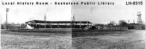 Original title:  Courtesy Saskatoon Public Library. Cairns Field grandstand and bleachers, from outfield. [between 1935 and 1940]