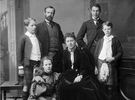 Original title:  Lord and Lady Aberdeen and family. L. to R. – standing: Dudley Gordon, Lord Aberdeen, George Gordon, and Archie Gordon – seated: Marjorie Gordon and Lady Aberdeen.  NATIONAL LIBRARY AND ARCHIVES; MIKAN 3423567