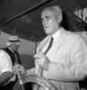 Titre original :  The Honourable C.D. Howe at the wheel of a tug during its launch ceremony at the Central Bridge Company.