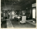 Original title:  Image from Hamilton Public Library, Local History and Archives. Wesanford, dining room, after 1917. A door at the southern end of the drawing-room leads into the dining-room, which many consider the handsomest portion of the house... The decorator has treated it in the style of the German renaissance and the big room, 50x28, lends itself well to this massive manner of handling, especially as the ceiling is twenty feet high, and the eastern end of the room is semi-circular. Around the sides runs a mahogany wainscotting, nine feet in height, panelled with fine Swiss wood-carvings of fruit, fish and game. ... An old brass chandelier of seventy-two lights hangs over a hospitable looking mahogany table twenty-eight feet long, of oval shape, with massive carved legs. This table can be enlarged on festive occasions to sixteen by thirty-three feet. Hamilton Spectator, June 8, 1892  The dining room table now stands in the Officers' Mess of the Royal Hamilton Light Infantray, in the John Weir Foote Armouries.  Not shown in the photo was the mechanical pipe organ, or Orchestrion.