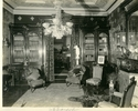 Original title:  Image from Hamilton Public Library, Local History and Archives.  Wesanford, the library, after 1917.  On the wall is a painting of Mrs Sanford by British artist Henry Harris Brown, present location unknown. The woodwork in this room, unchanged from the 1877 remodelling, is by the Hoodless Company of Hamilton.  Opposite the drawing room the library, with a deep blue wall of silken tapestry, affording relief to the dark walnut of the dado and the light russet of the ceiling's centre, which is charmingly shaded back to the blue of the walls. The mahogany floor is very rich. Toronto Empire, June 13, 1892.