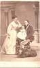 Original title:  Image from Hamilton Public Library, Local History and Archives. Photo of W.E. Sanford and his second wife, Harriet Sophie Vaux (1848-1938). Sanford is holding their first child, Edward Jackson Sanford, born in St Paul Minnesota, in June 1867.