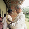 Original title:  Cardinal Léger holding a child named Lisa at the Centre for Handicapped Children in Yaoundé.