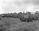 Original title:  Tank crews of The British Columbia Dragoons lined up in front of their Sherman tanks during a review by General H.D.G. Crerar followed by a mounted marchpast, Eelde, Netherlands, 23 May 1945.