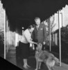 Titre original :  Rt.Hon. John George Diefenbaker, Prime Minister of Canada, and Mrs. Olive Diefenbaker with pet dog on door step of official residence, 24 Sussex Drive.