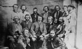 Original title:    Description English: Councillors of the Provisional Government of the Métis Nation. Front row, L-R: Robert O'Lone, Paul Proulx. Centre row, L-R: Pierre Poitras, John Bruce, Louis Riel, John O'Donoghue, François Dauphinais. Back row, L-R: Bonnet Tromage, Pierre de Lorme, Thomas Bunn, Xavier Page, Baptiste Beauchemin, Baptiste Tournond, Joseph (Thomas?) Spence Français : Conseillers du gouvernement provisoire de la nation métisse Date 1870(1870) Source This image is available from Library and Archives Canada under the reproduction reference number PA-012854 and under the MIKAN ID number 3194516 This tag does not indicate the copyright status of the attached work. A normal copyright tag is still required. See Commons:Licensing for more information. Library and Archives Canada does not allow free use of its copyrighted works. See Category:Images from Library and Archives Canada. Aut