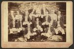 "Titre original :    Description Photograph shows a team portrait of the St. Louis Browns baseball team in 1888, with players seated, each wearing a striped coat over their baseball uniform; includes a young boy, the ""Browns Mascot"", seated in the back row between two players, and two dogs in the foreground. Each player is numbered, which corresponds to a numbered identification key printed on the card mount below the photograph. Caption continues: Champions of Am. Association four successive years, 1885, '86, '87, '88. World Champions, 1886, 1887. Players include: Jack Boyle, Bill White, Nat Hudson, Jim Devlin, Icebox Chamberlain, Yank Robinson, Arlie Latham, Captain Charlie Comiskey, Tommy McCarthy, Tip O'Neill, Harry Lyons, Jocko Milligan, Silver King, Tom Dolan, and Ed Herr. Date 1888(1888) Source The famous world beaters St. Louis Browns (LOC)   This image is available from the United States Li"
