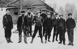 Original title:  Dr. Norman Bethune. Victoria Harbour Lumber Co., Martin's camp. Dr. Bethune is standing straddle legs with hands on hips: Alfred Fitzpatrick, founder of Frontier College, standing 3rd from right. 1911 / Pinage (?) Lake, Ont.  Credit: Library and Archives Canada / C-056826 A