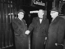 Original title:  L. to R.: Hon. Paul Martin, Hon. Lester B. Pearson and the Rt. Hon. Louis St. Laurent at Ottawa after Pearson's return from Norway with the Nobel Peace Prize.