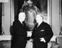 Original title:  Rt. Hon. W.L. Mackenzie King congratulating Rt. Hon. Louis St. Laurent on his appointment as Prime Minister of Canada, Rideau Hall.