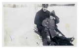 Original title:  W.J. Pentland and son William Thomas tobogganing in High Park. Image courtesy of the grandchildren of W.J. Pentland.