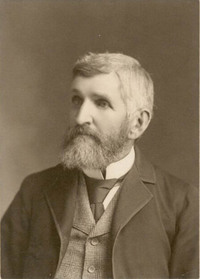 Original title:  Black and white photograph of man in a suit with full beard