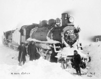 Original title:  [Canadian Northern Railway locomotive No. 2036 at Mair station Sask.].