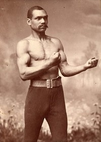 Original title:    Description English: Old Chocolate George Godfrey, notorious canadian boxer. Português: Old Chcolate George Godfrey, lendário pugilista canadense. Date Antes 1923 Source http://www.be-hold.com/content/Boxers/images/040.jpg Author Desconhecido