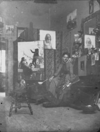Original title:  Probably George A. Reid's wife (Mary Hiester) in a studio (Copy)