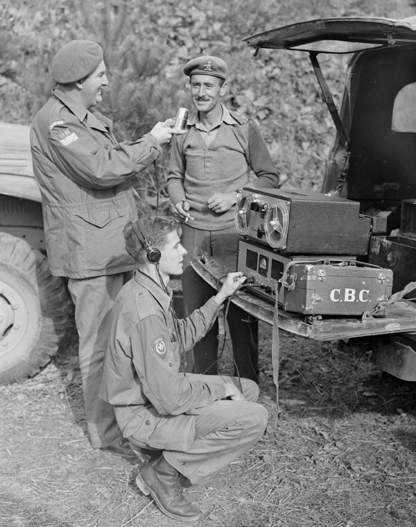 Original title:  Normand Eaves, at the mike, and Norman McBain, at the controls, interviewing Lt. Col. James Dextraze, commanding officer of the Royal 22nd Regiment.