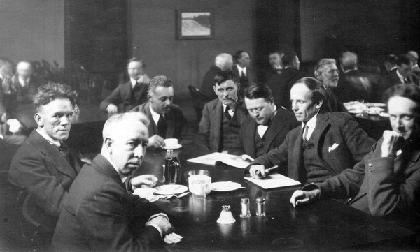 Original title:    DescriptionGroup-of-seven-artists.jpg English: Six of the Group of Seven, plus their friend Barker Fairley, in 1920. From left to right: Frederick Varley, A. Y. Jackson, Lawren Harris, Fairley, Frank Johnston, Arthur Lismer, and J. E. H. MacDonald. It was taken at The Arts and Letters Club of Toronto. Date 1920 Source Unknown Author Arthur Goss
